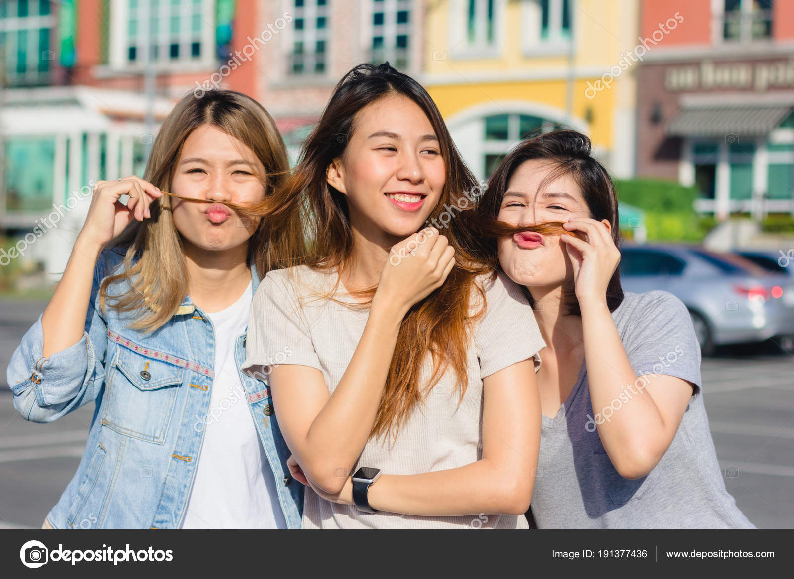 91921a397f2 Happy young Asian women group city lifestyle playing and chatting each  other among the pastel building ...