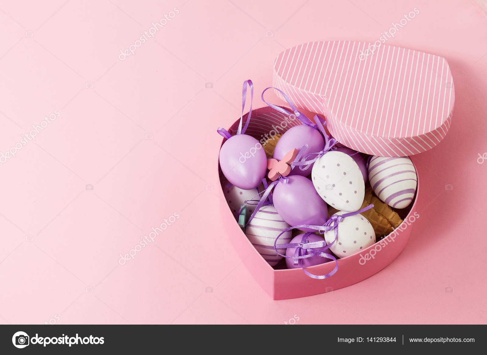 Easter or spring concept easter eggs in beautiful heart shaped easter or spring concept easter eggs in beautiful heart shaped gift box top view photo by nerudol negle Images