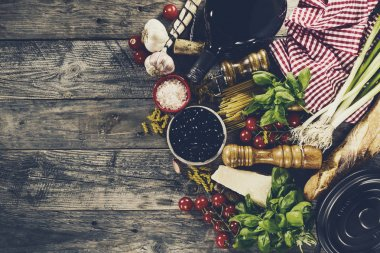 Tasty fresh appetizing italian food ingredients on old rustic table