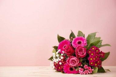 Lush beautiful bouquet on pink