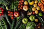 Fotografie Assortment of tasty vegetables and fruits