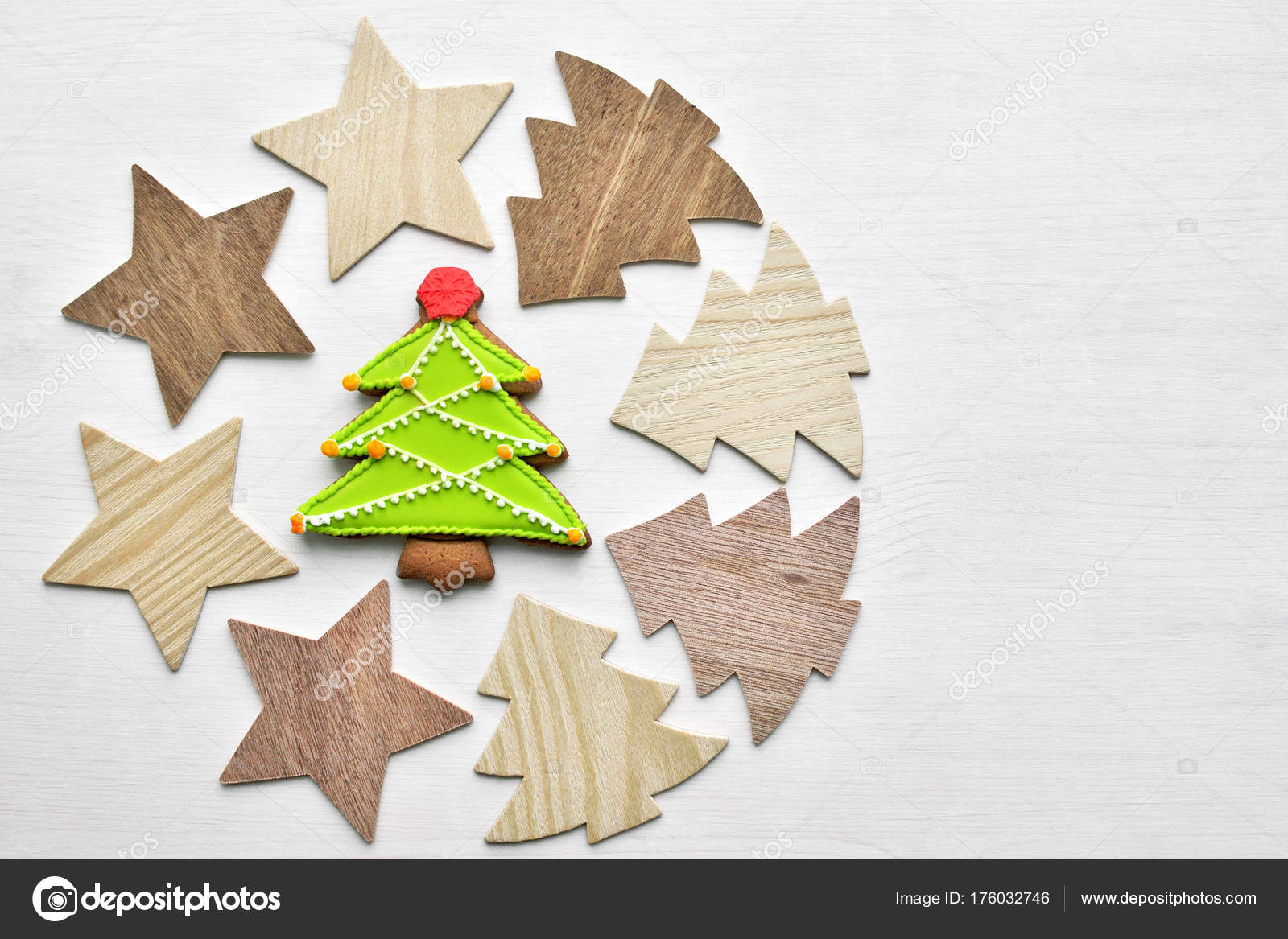 wooden christmas trees and stars background baked gingerbread glazed cookies new year decoration background top view space for text photo by nikavera