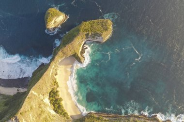 Aerial view of Kelingking Beach also called Manta Bay with big wave, blue ocean located in Nusa Penida, Indonesia.