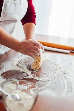 Woman preparing Christmas Cookies dough