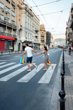 Couple running across the street