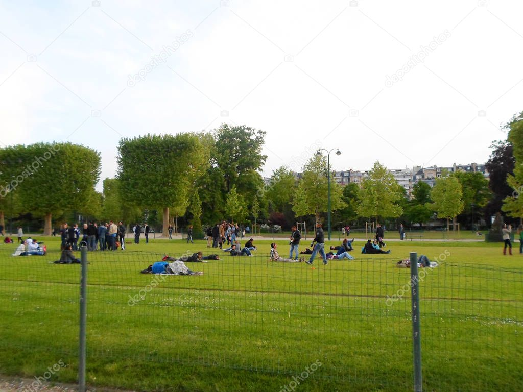 People resting on the Champ de Mars