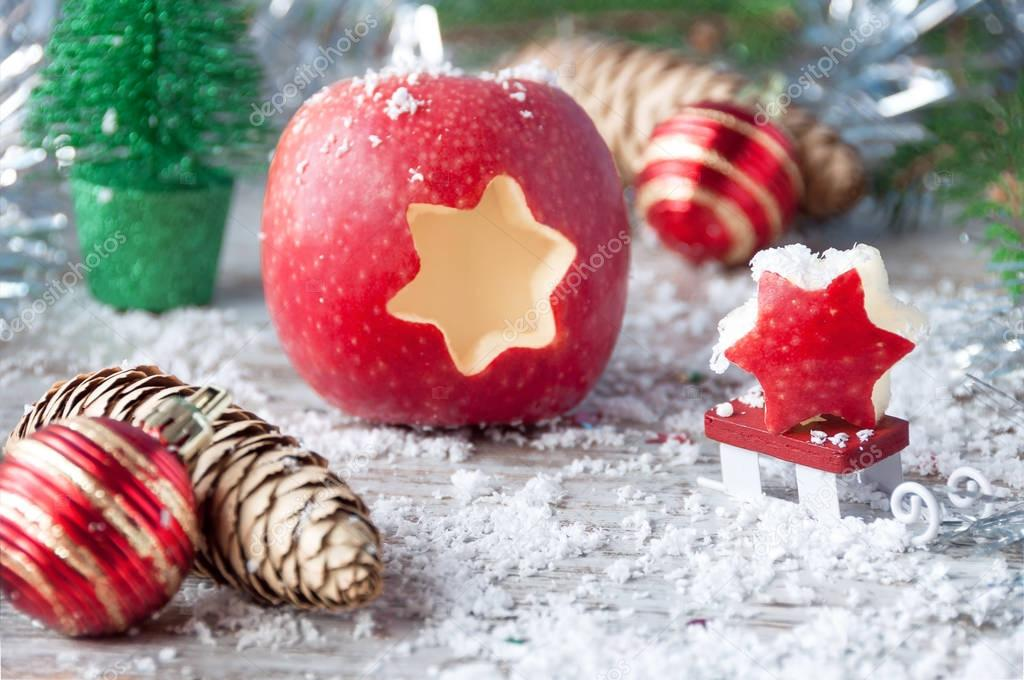 Christmas apple with selective focus on wooden surface. New Year