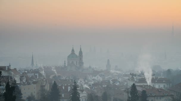 The Church of Saint Nicholas, sunrise over Prague
