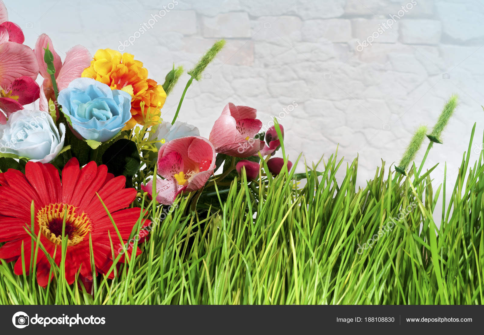 Beautiful bouquet of flowers on the wall background stock photo beautiful bouquet of flowers on a brick wall background photo by yuliialypai izmirmasajfo