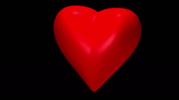 srdce se projevuje částic na černém pozadí, video smyčky