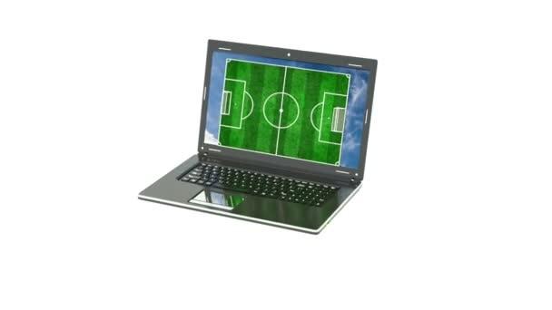das Fußballfeld erscheint vom Laptop-Bildschirm, das Konzept der Online-Fußballübertragungen, Online-Fußballspiele und Fußball im Allgemeinen