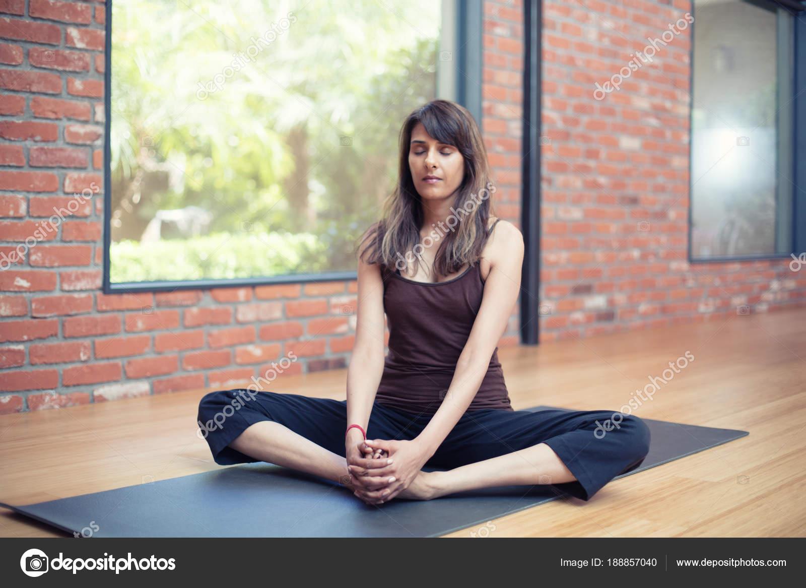 Indian Girl Practicing Yoga In A Studio Stock Photo C Lstock 188857040