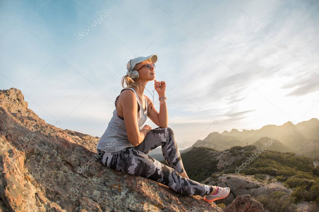 Music lover at the peak of the huge mountain, outdoor leisure quality time