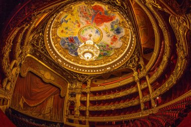 Paris, France - October, 2017: Auditorium inside of the Palais Garnier Opera Garnier in Paris, France. The ceiling area painted by Marc Chagall depicts scenes from operas by 14 composers.