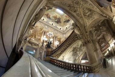 Paris, France - October 2017: The large ceremonial staircase of white, red and green marble divides into two divergent flights of stairs that lead to the Grand Foyer.