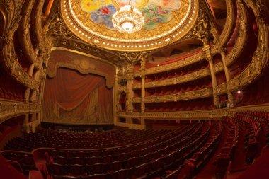 Paris, France - October, 2017: Auditorium inside of the Palais Garnier Opera Garnier in Paris, France. The seven-ton bronze and crystal chandelier was designed by Garnier.