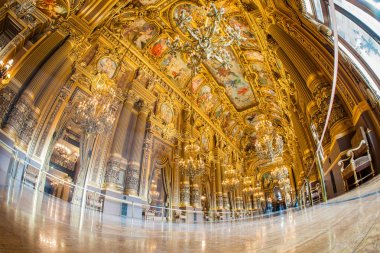 Paris, France - October 2017: Grand foyer inside of the Palais Garnier Opera Garnier in Paris, France. Its ceiling by Paul-Jacques-Aim Baudry and represents moments in the history of music.