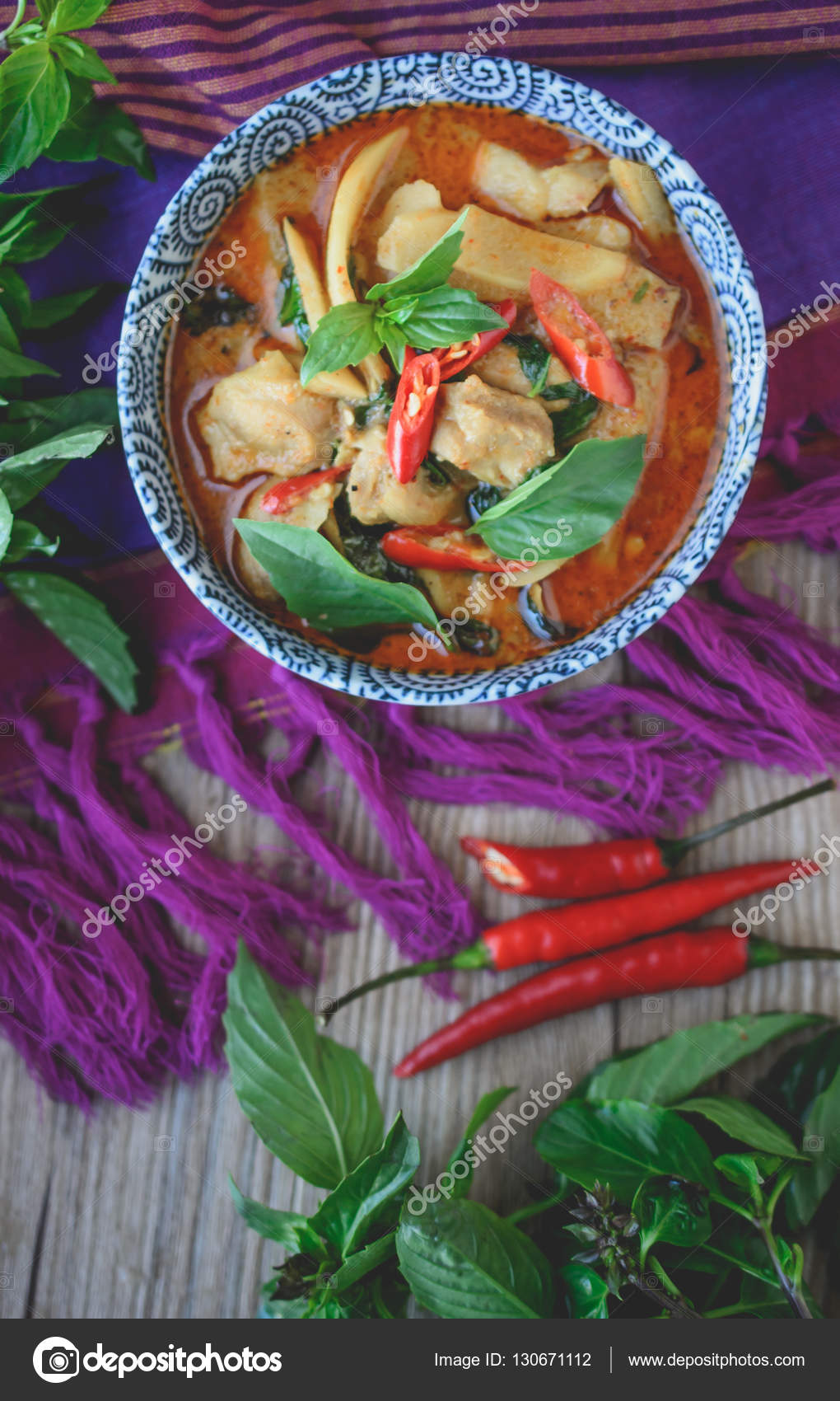 f640c3c8 Thai Chicken Red Curry on Thai Fabric and Old Wooden Background — Stock  Photo