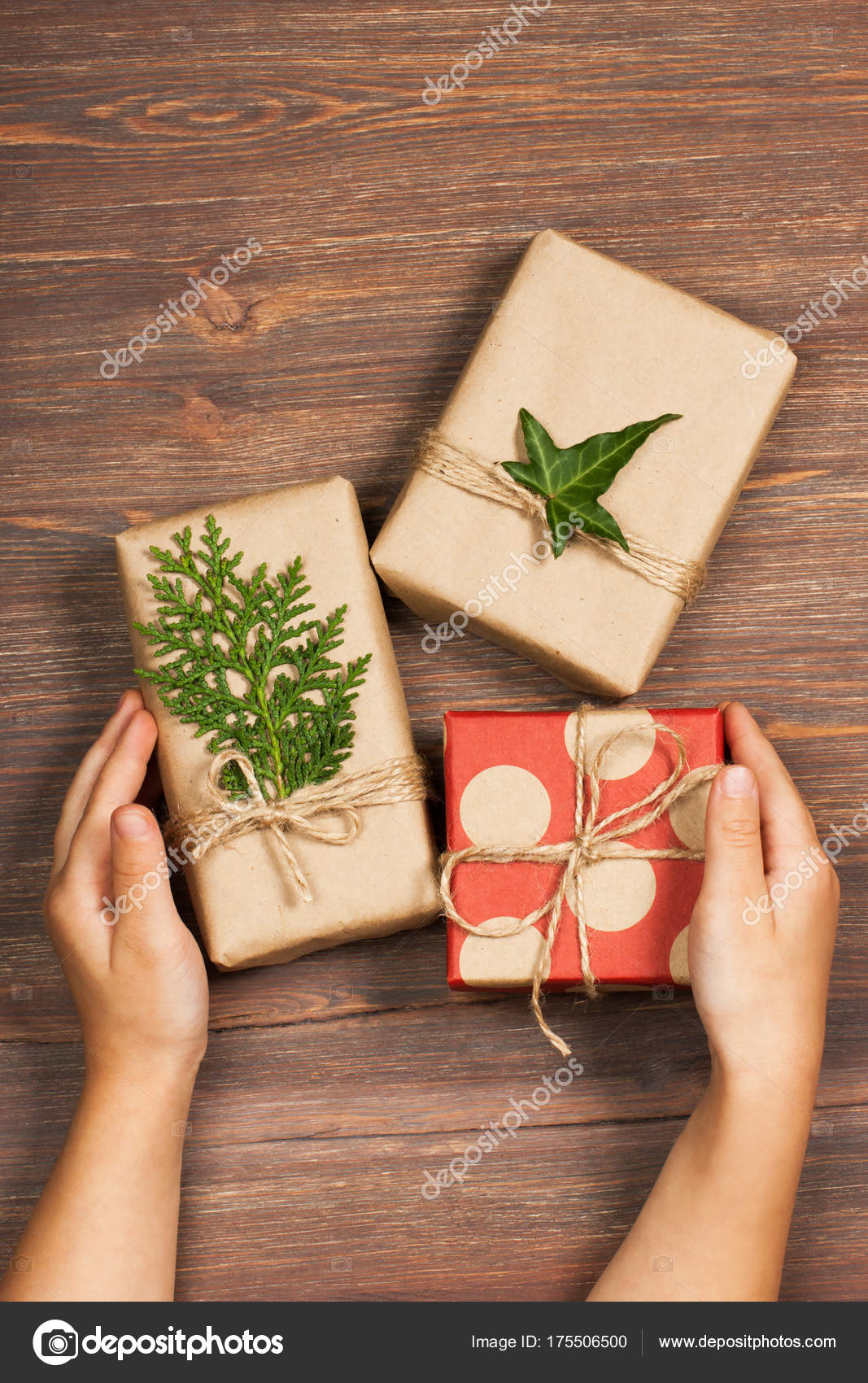 Gifts packed in a minimalistic style on a wooden background. The ...