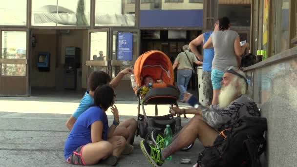 BRNO, CZECH REPUBLIC, MAY 15, 2017: Authentic family and homeless smokes marijuana, marihuana on the street, near train station Brno, South Moravia, Europe, EU