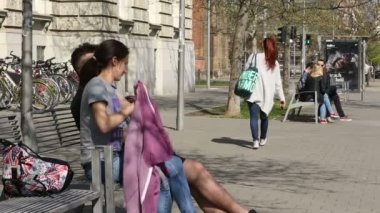 Authentic asian students foreign beautiful girl University in Brno sitting and talking before school, girl, boy