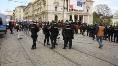March of radical extremists, suppression of democracy, against  European Union, police, flags