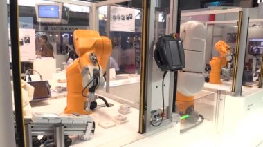 PRAGUE, CZECH REPUBLIC, OCTOBER 1, 2017: A universal technological automated robot shoulders for industrial innovative work. Very unique scientific technique, exhibition and fair