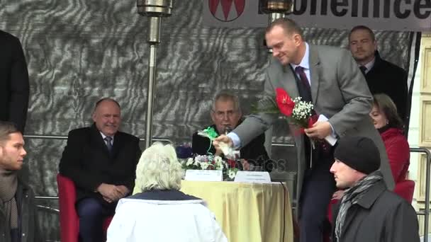 President of the Czech Republic Milos Zeman visiting Mohelnice, senior woman gives the president a flower and a gift