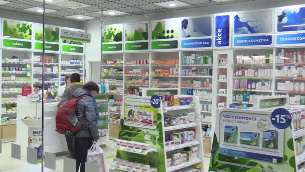 PRAGUE, CZECH REPUBLIC, NOVEMBER 27, 2017: Authentic operation of pharmacy interior, customers and pharmaceuticals brings medicines, shelves with food supplements, Europe, European Union