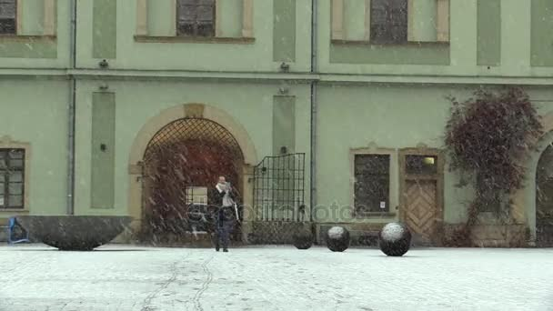 OLOMOUC, CZECH REPUBLIC, JANUARY 3, 2018: Calamity in winter, snowstorm blizzard with a great snowfall, people are shocked problem for pedestrians, walking people in snow
