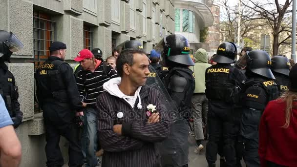 BRNO, CZECH REPUBLIC, MAY 1, 2017: Police riot unit oversees, gypsy man, czech activists protest first may day against extremists. Demonstration of radical extremists, suppression of European Union