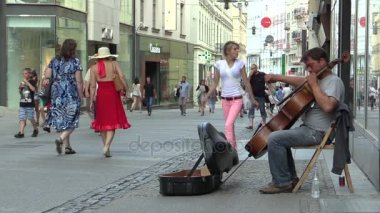 BRNO, CZECH REPUBLIC, AUGUST 11, 2017: Street musician plays on a double bass string instrument on the street of the city of Brno and begging money, very beautiful music and authenticity