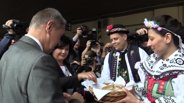 BRNO CZECH REPUBLIC, MAY 2, 2018: Prime Minister Andrej Babis arrived for the citizens of Brno, was welcomed by a man and a woman in traditional folk costumes from southern Moravia, Czech Republic