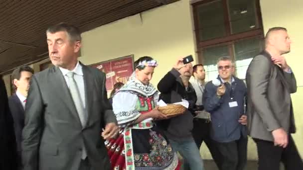 BRNO CZECH REPUBLIC, MAY 2, 2018: Prime Minister Andrej Babis arrived for the citizens of Brno, was welcomed by a woman in traditional folk costumes from southern Moravia go to the train station