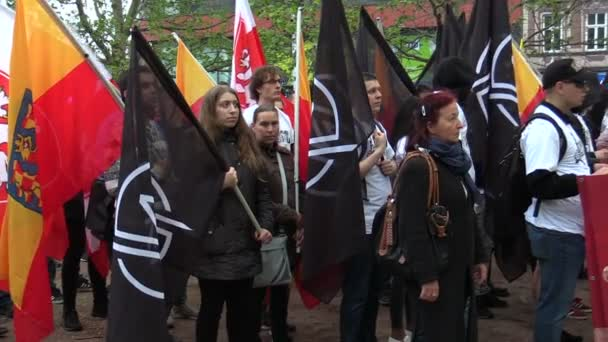 BRNO, CZECH REPUBLIC, MAY 1, 2019: National Social Front Czech demonstration flag people, is forming a procession crowd and a gathering for a march. March of radical extremists