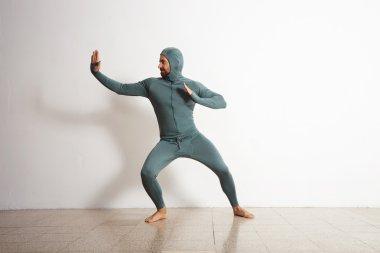 athlete male acting like a ninja