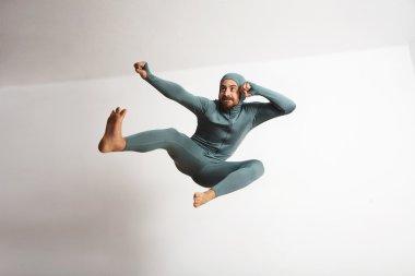 athlete male acting like ninja