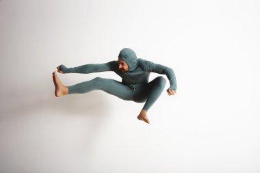 athlete jumping like a ninja in air