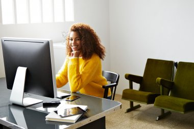 black lady working in small industrial office