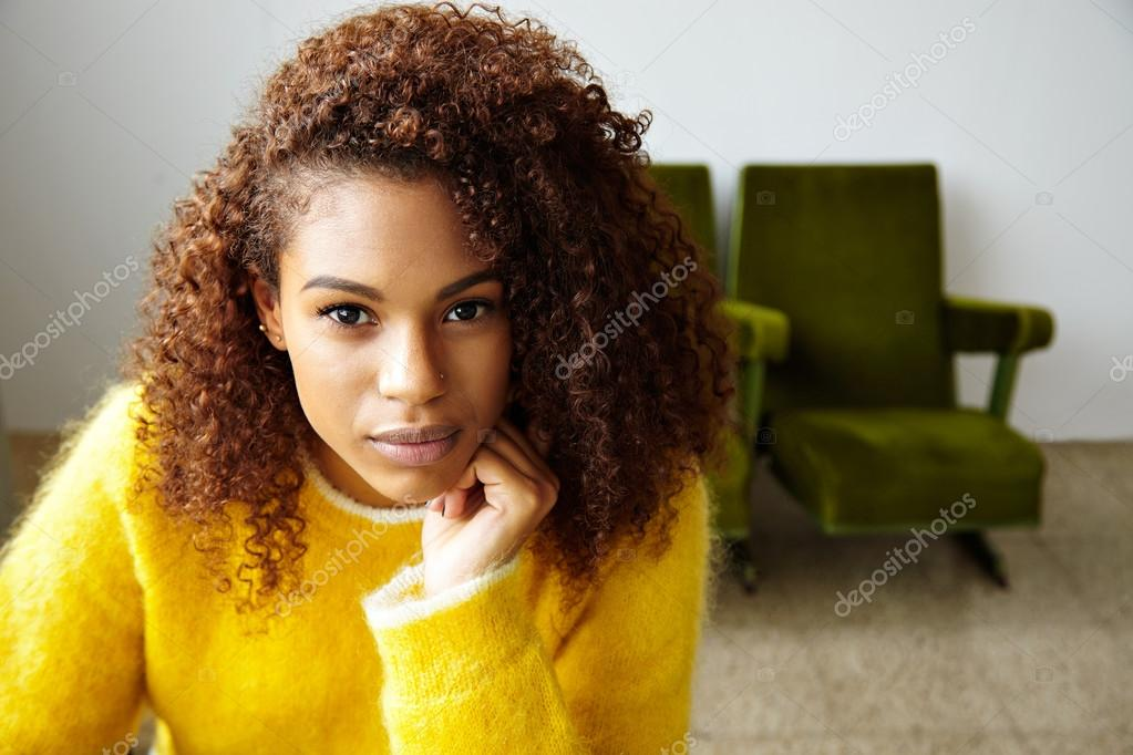Black Girl With Curly Hair Looking On Camera Stock Photo
