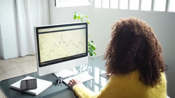 black businesswoman working with graph on computer
