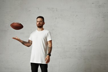 man throwing brown vintage football