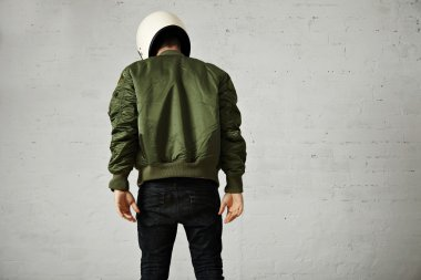 Man in green bomber jacket with helmet
