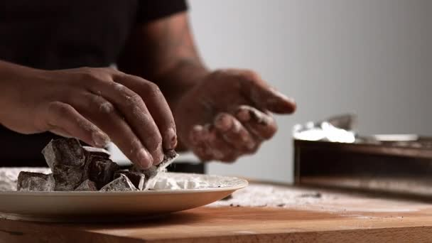 Professional chief works with chocolate, isolated on white background