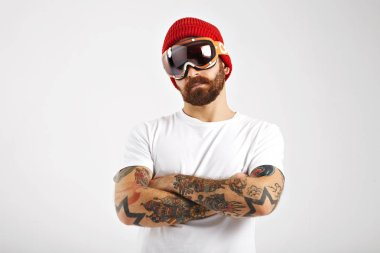 Tattooed and bearded snowboarder in blank white t-shirt
