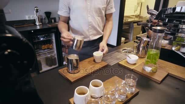 Barista works in artisan cafe shop
