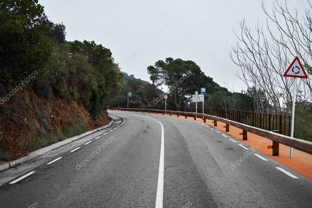 Curved blind turn on mountain road