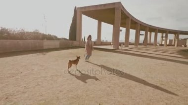 Attractive girl walks with dog