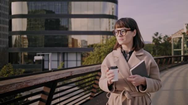 Attractive brunette girl walks on urban streets