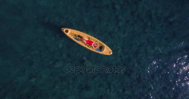 Aerial of pretty tourists on kayak in ocean